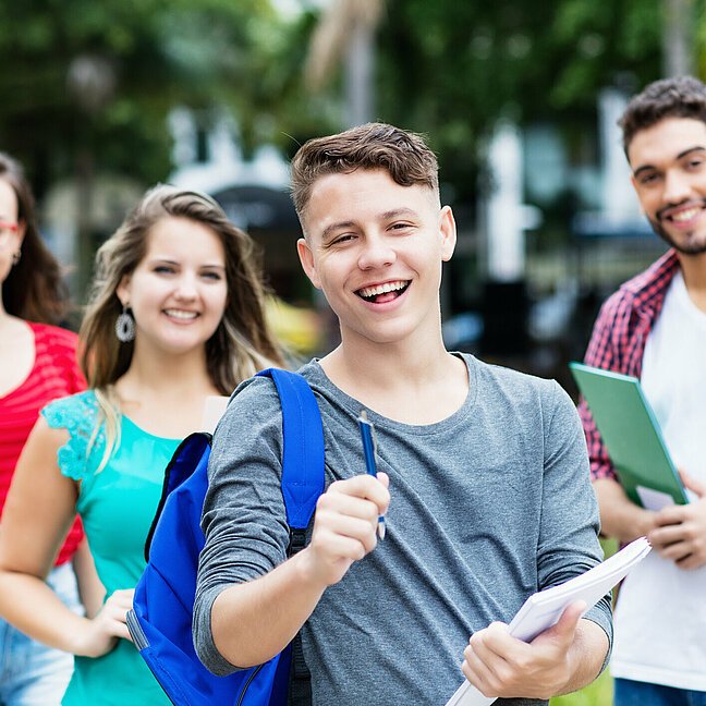 German male student with group of other students